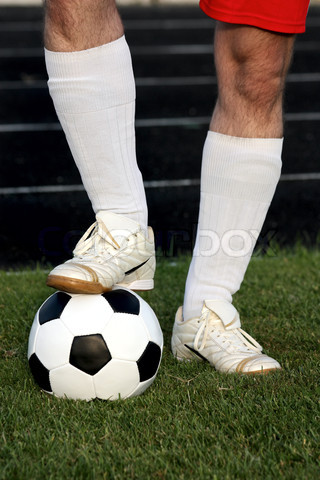 Image of  Legs of soccer player with classic soccer ball over HD Wallpaper